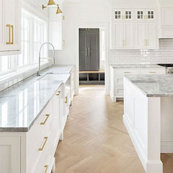 gold kitchen home depot sinks undermount solid wood cabinets blog page 9 of 40 a clean white with wooden herringbone floor marble worktop and handles