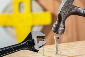 Two nails, a wrench and a hammer