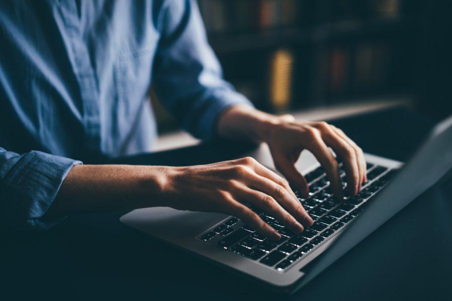 Photo is of Korneevamaha via Twenty20 and shows someone typing on his laptop