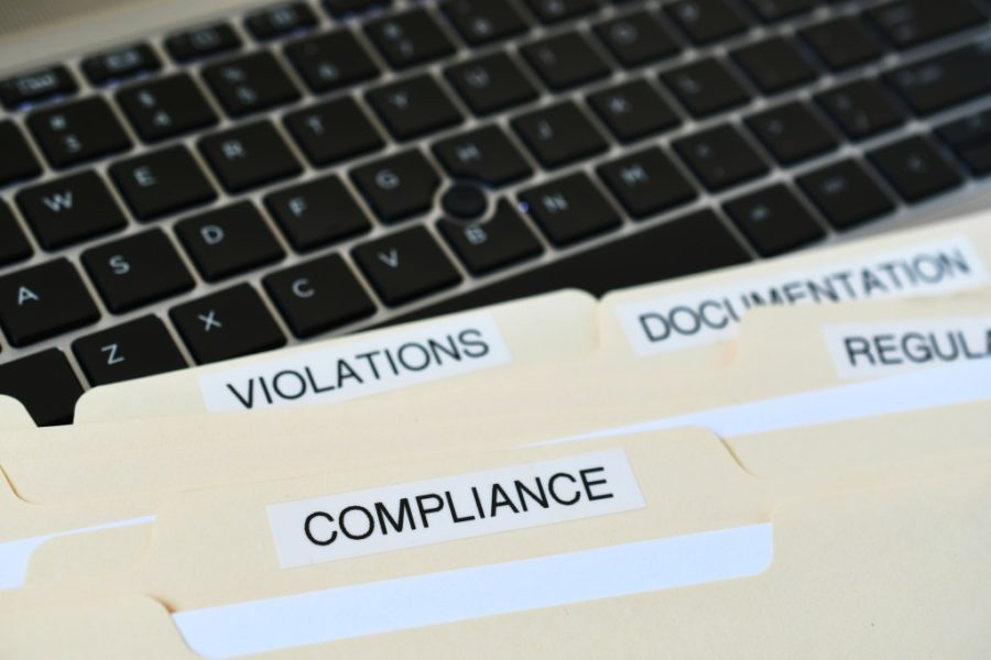 compliance-in-the-workplace-folders-containing-paperwork-regarding-changing-procedures-to-adhere-to_t20_WJAOYm