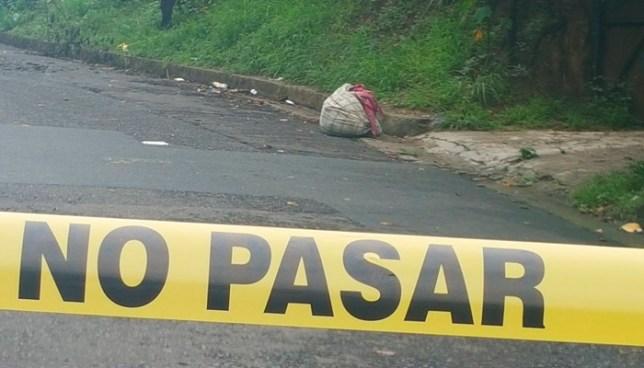 Lanzan cadáver de un hombre envuelto en sabanas en calle Agua Caliente, Soyapango