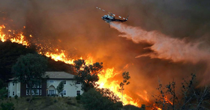 Más de 21.000 personas evacuadas por incansables llamas que devoran el sur de California