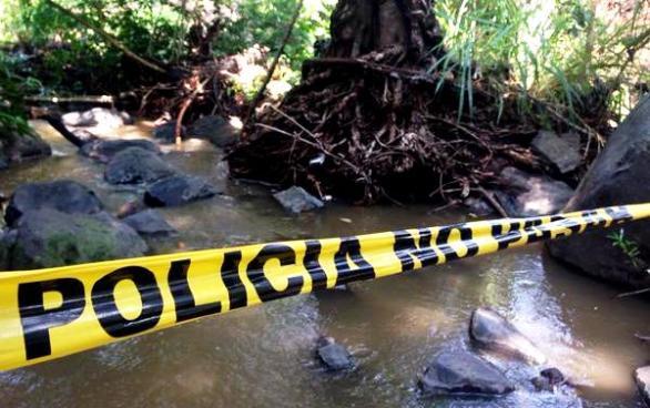 Encuentran cadáver en la orilla del río Julupe en Sonsonate