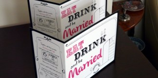 Retro and clean wedding invitations with pink and black writing saying 'eat drink and be married'