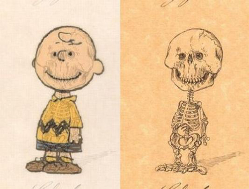 A smiling Charlie Brown poses in both flesh and bone
