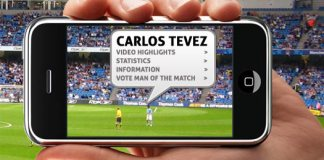 Carlos Tevez football player stands on football pitch in football stadium whilst a supporter sees his statistics virtually appear on his phone