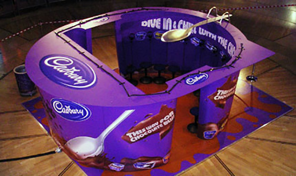 Photo of Cadbury's exhibition stand shaped like one of their products - the 'pot of joy'