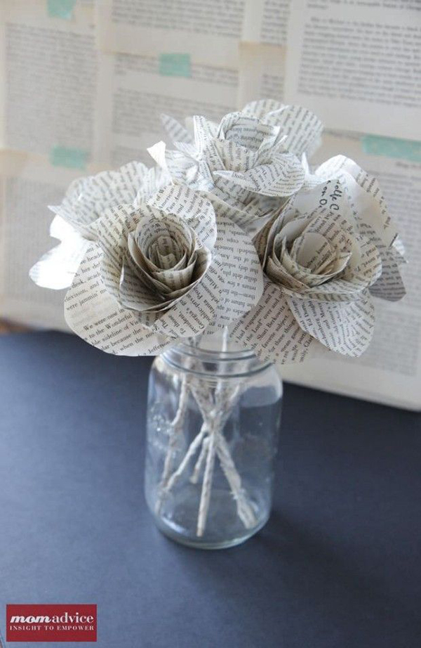 Jar of paper flowers with book writing on them