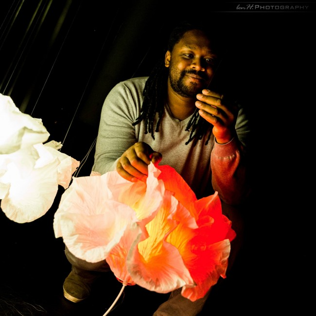 Photo of Junior Fritz Jacquet and his paper art