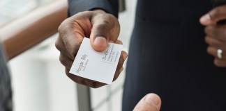 Person Offering Business Card