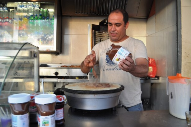 Mr. Norddine Bakhouilli Makes a Delicious Nutella Crepe at Le Mediterranee has a Sandwich & Crepe Shop on Cours Jean Ballard in Marseille, France.