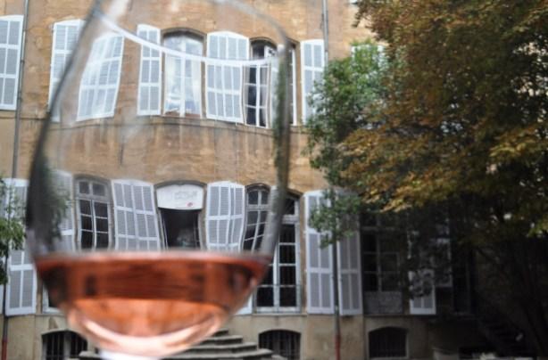 Viewing Hôtel de Gallifet in Aix-en-Provence, France, through a Glass of Rose Wine from Mas de Cadenet