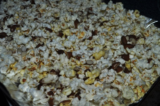 Spread the Popcorn and Chopped Almonds Out on a Lined Baking Sheet