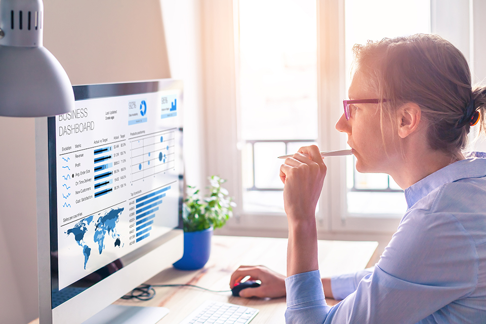Businesswoman using business analytics or intelligence dashboard