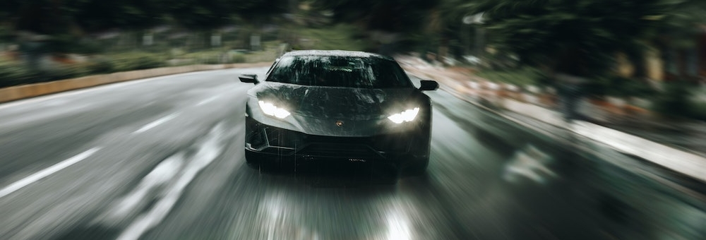 Blog header image of a fast car racing along a road for the blog on the Faster, Easier Way to Manage KPIs in 2021 with Reporting Software blog from Solver, a developer of Corporate Performance Management / Budgeting and Reporting software
