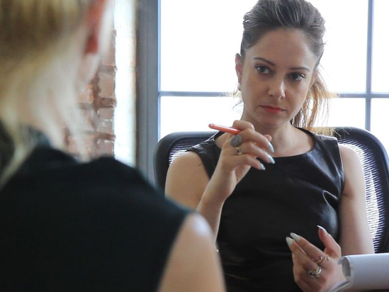 Sexual assault attorney Carrie Goldberg in her office with a client in Netizens, directed by Cynthia Lowen.