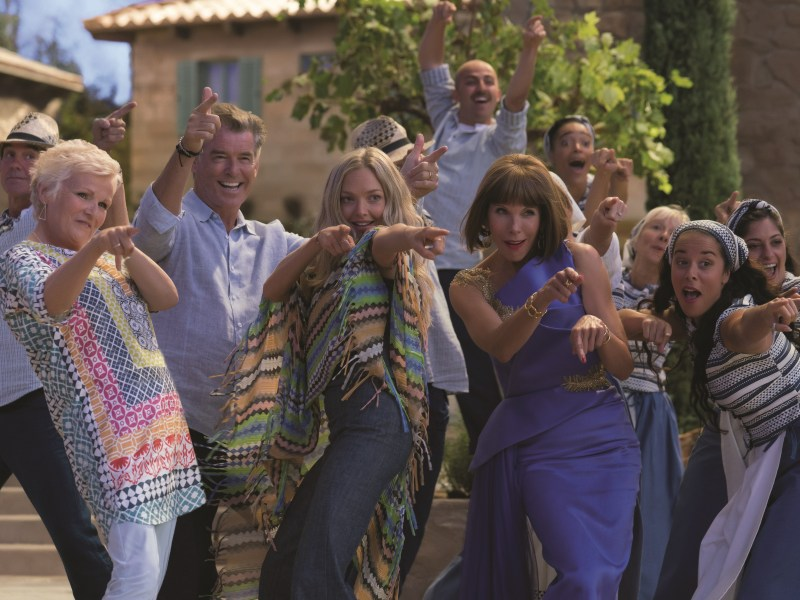 "Rosie (JULIE WALTERS), Sam (PIERCE BROSNAN), Sophie (AMANDA SEYFRIED) and Tanya (CHRISTINE BARANSKI) in ""Mamma Mia! Here We Go Again."" Ten years after ""Mamma Mia! The Movie,"" you are invited to return to the magical Greek island of Kalokairi in an all-new original musical based on the songs of ABBA."