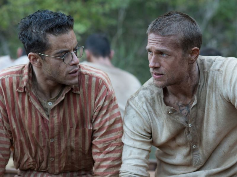 "Rami Malek (left) stars as ""Louis Dega"" and Charlie Hunnam (right) stars as ""Henri 'Papillon' Charriére"" in director Michael Noer's PAPILLON, a Bleecker Street release."