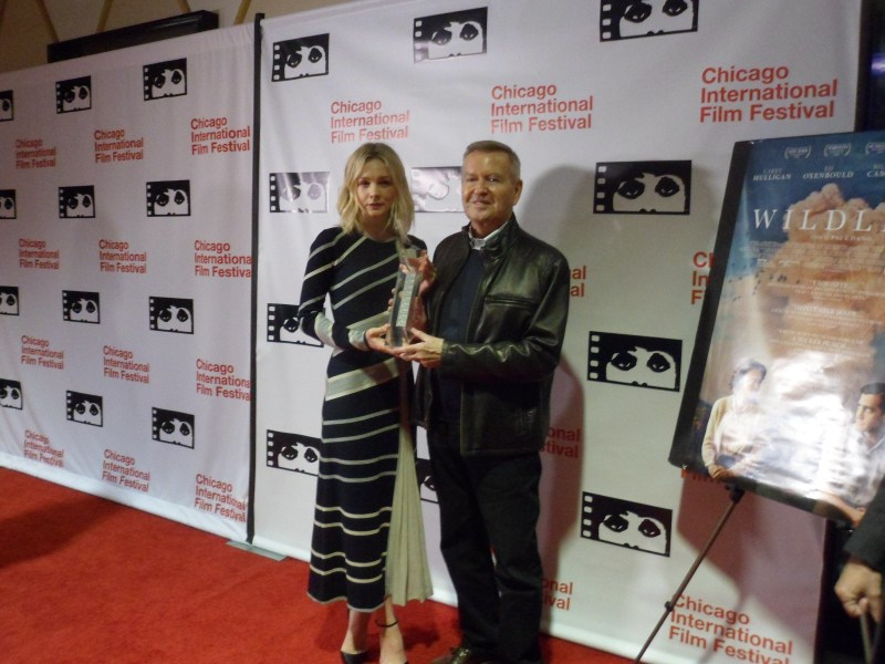 Carey Mulligan is presented with the Artistic Achievement Award by Michael Kutzla at the 54th Chicago International Film Festival.
