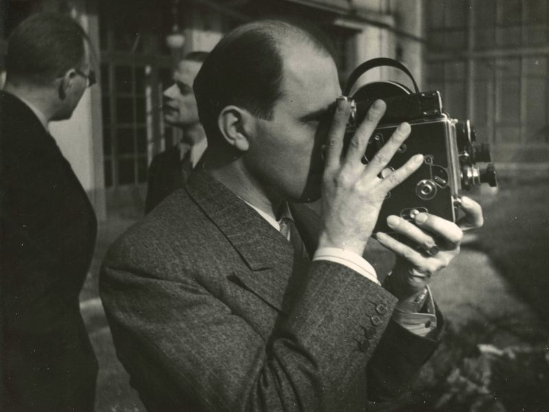 Bolex inventor Jacques Bolsey holds his invention in a photo from Beyond the Bolex.