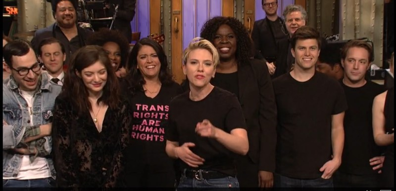 """Cecily Strong wears a """"Trans Rights are Human Rights"""" shirt during the Saturday Night Live goodnights when Scarlett Johansson hosted SNL on March 11, 2017."""