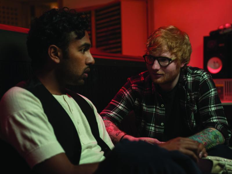 Jack Malik (Himesh Patel) gets a major career boost from Ed Sheeran (playing himself) after Jack begins performing songs by The Beatles, in Yesterday, directed by Danny Boyle.