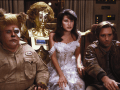 Barf (John Candy), Dot Matrix (Lorene Yarnell Jansson/Joan Rivers), Princess Vespa (Daphne Zuniga), and Lone Starr (Bill Pullman) in Spaceballs.