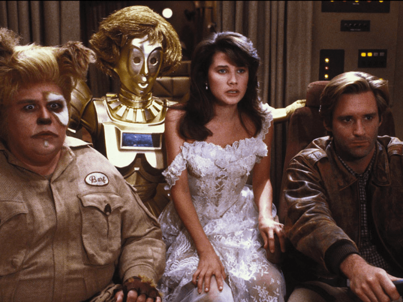 Barf (John Candy), Dot Matrix (Lorene Yarnell Jansson/Joan Rivers), Princess Vespa (Daphne Zuniga), and Lone Starr (Bill Pullman) in Spaceballs.