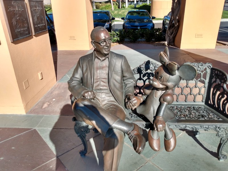 A statue of Roy Disney and Minnie Mouse.