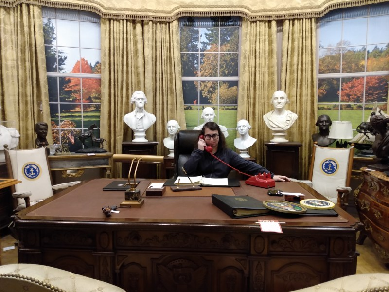 Danielle Solzman speaking on the phone in the Oval Office.