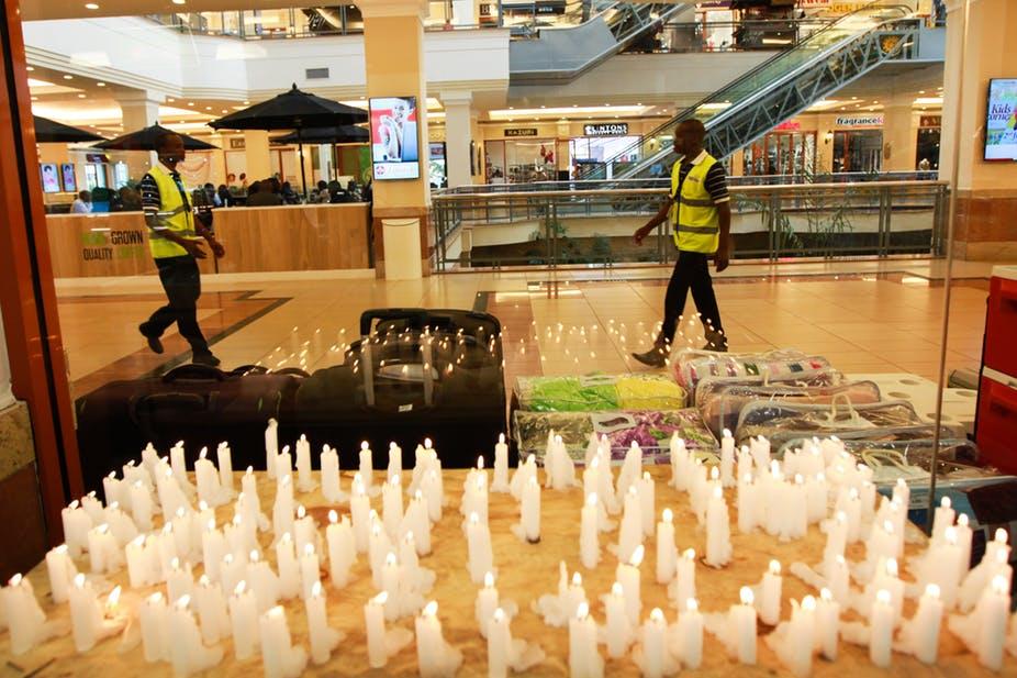 Candles in memory of those killed in Nairobi's Westgate Mall attack in September 2013. EPA/Daniel Irungu