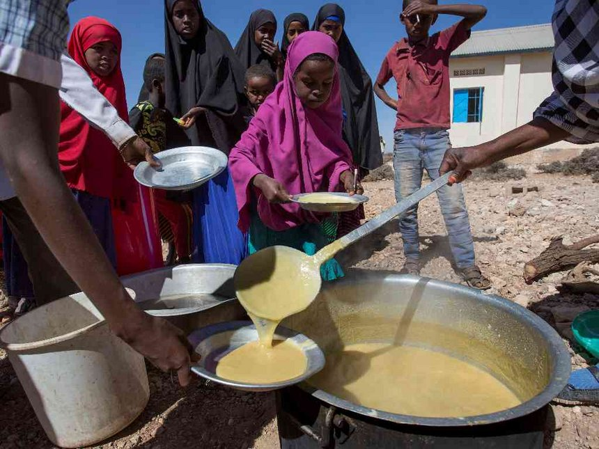 Children receive a meal at a school through the World Food Programme (WFP) in the drought-hit Baligubadle village near Hargeisa, the capital city of Somaliland, in this handout picture provided by The International Federation of Red Cross and Red Crescent Societies on March 15, 2017.