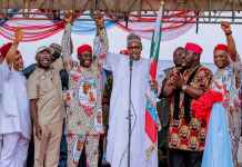 Nigerian President Muhammadu Buhari holding a flag during a recent campaign rally. He is running for a second term in office. EPA-EFE/STR