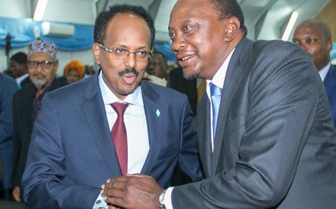 President Uhuru Kenyatta with Somali President Mohamed Abdullahi Farmaajo, during inauguration ceremony in Mogadishu, on Febraury 22, 2017. [File, Standard]