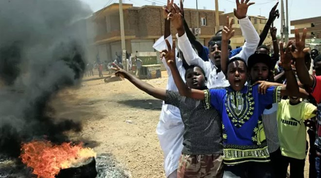 Residents demonstrate in the streets of Khartoum to demand that the country's Transitional Military Council hand over power to civilians. Picture: Reuters
