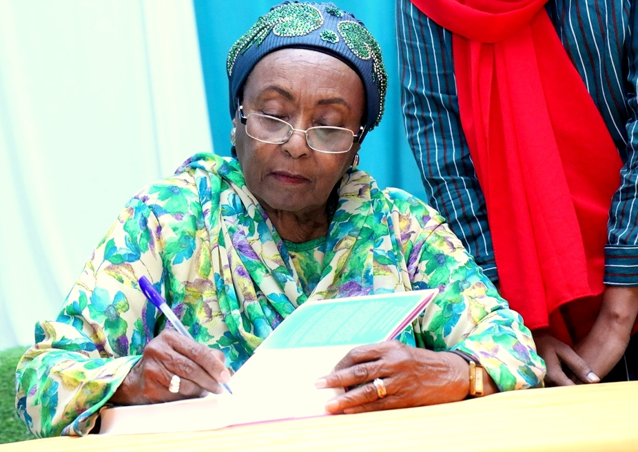 Dr. Edna signing the books during the launching ceremony