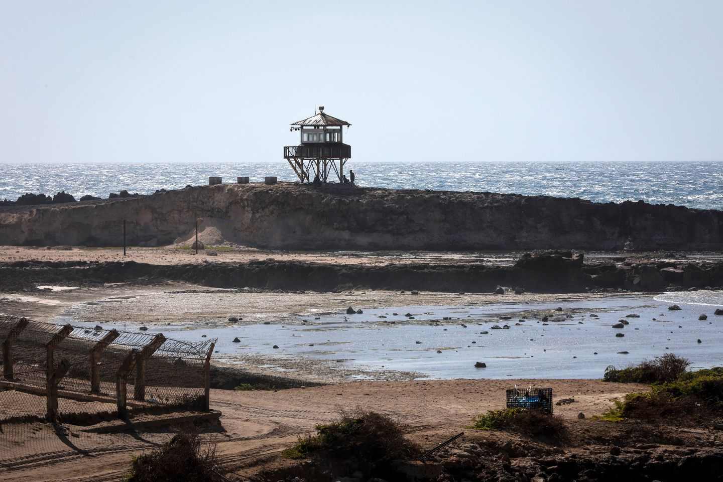Soldiers sit at a watch post next to the runway inside Mogadishu airport's secure perimeter, where international organizations such as the United Nations and European Union are based, in Mogadishu, Somalia. (Dai Kurokawa/EPA-EFE/REX/Shutterstock)