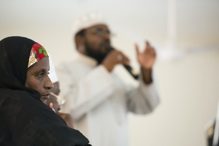 An Imam addresses a Kenyan Muslim Youth Alliance meeting flanked by community leaders. (Photo by Neil Thomas/Corbis via Getty Images)