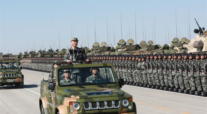 President Xi Jinping inspects the armed forces to mark the 90th founding anniversary of the People's Liberation Army (PLA) at Zhurihe military training base in Inner Mongolia, July 30, 2017. /Xinhua Photo