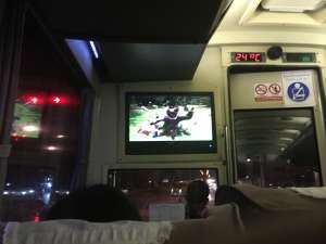 Watching TV on an Asian overnight bus