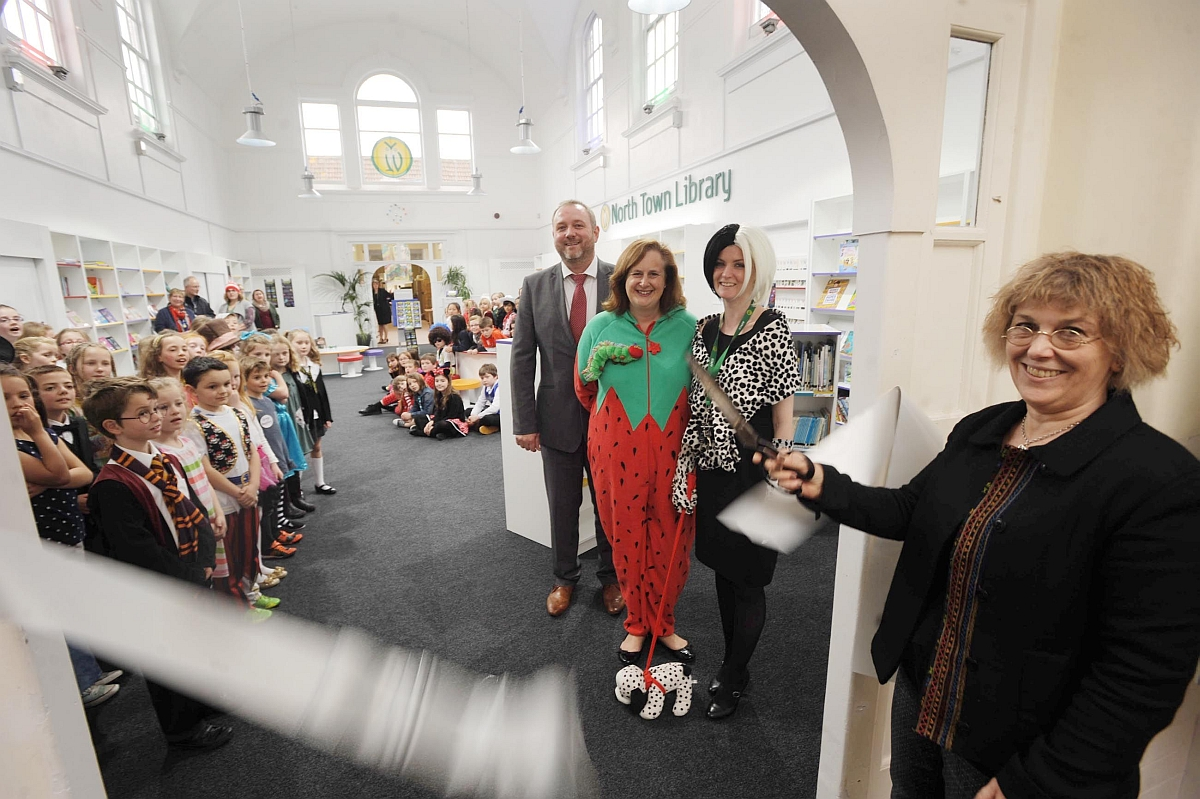 Somerset County Gazette: Angie Sage cuts the ribbon to open the new library.