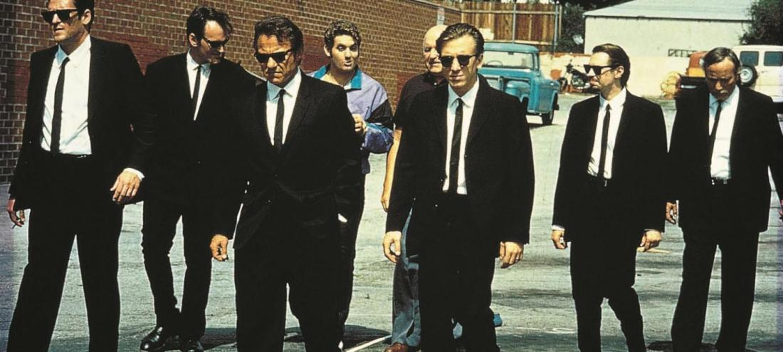 Film still of a group of men in suits
