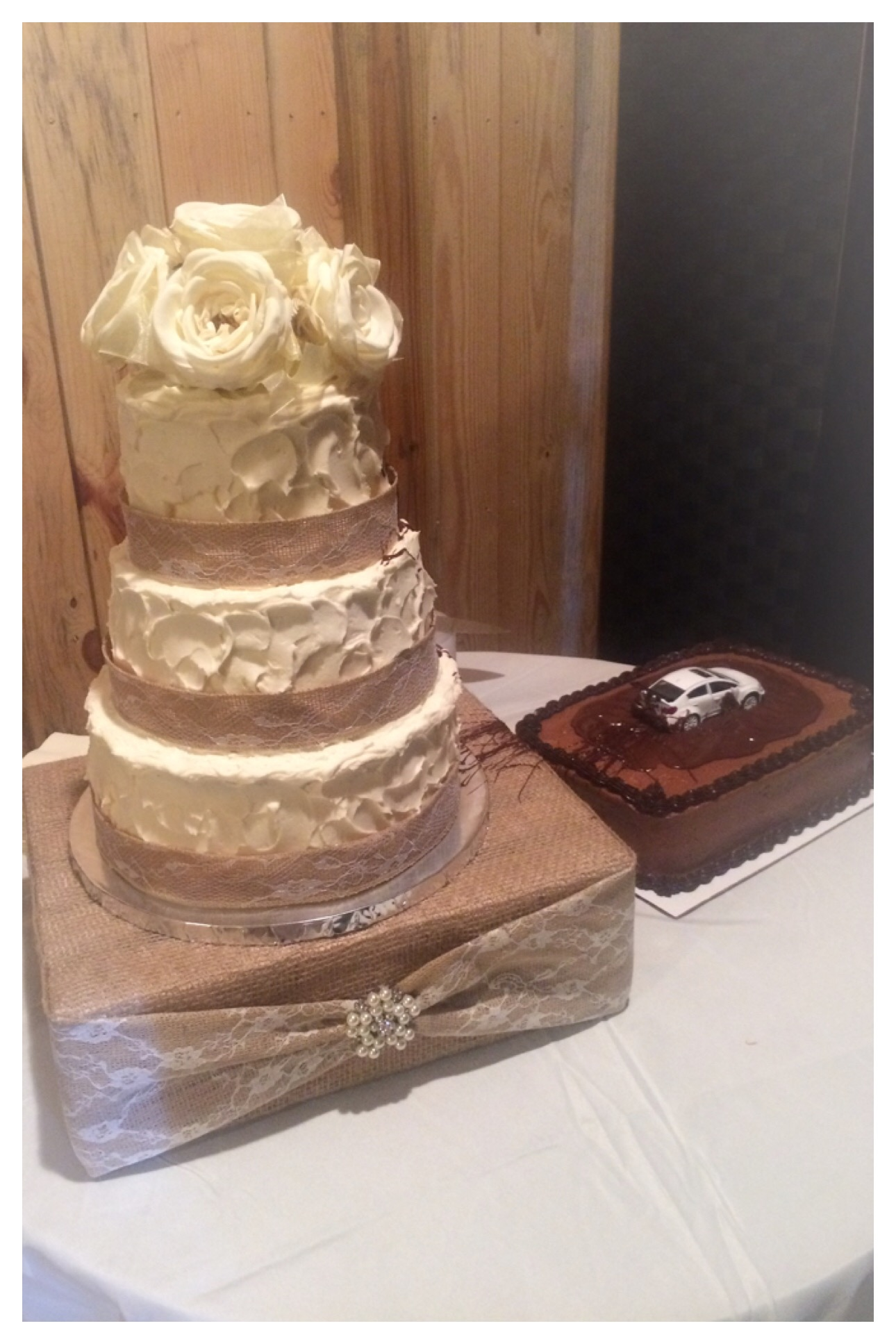rustic wedding cake with swirl textured buttercream finish, silk flower topper, burlap and lace ribbon, and car peel out chocolate groom's cake