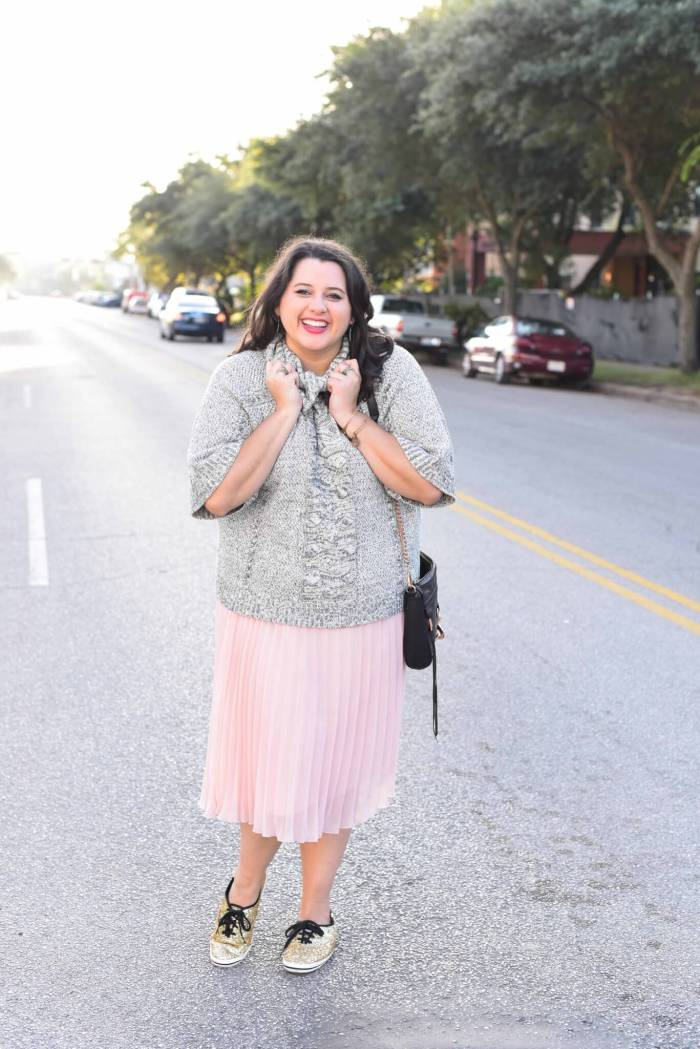 Being cozy this time of year is essential. Emily Bastedo from the curvy style blog, Something Gold, Something Blue is sharing her take on the perfect brunch outfit with a grey oversized turtleneck from Anthroplogie contrasted with a soft pink pleated skirt, glitter Kate Spade Keds and a few cute accessories.