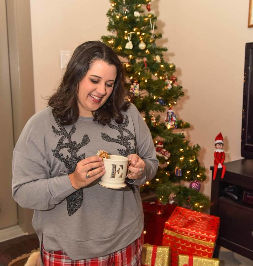 Nothing says Christmas morning quite like a mug of hot chocolate and a pair of cozy Christmas PJs. I'm sharing what to wear on Christmas morning to be comfortable and stylish while opening presents with family and friends. This cozy holiday post was written by plus size style blogger, Emily Bastedo of the blog Something Gold, Something Blue - @EmilySGSB