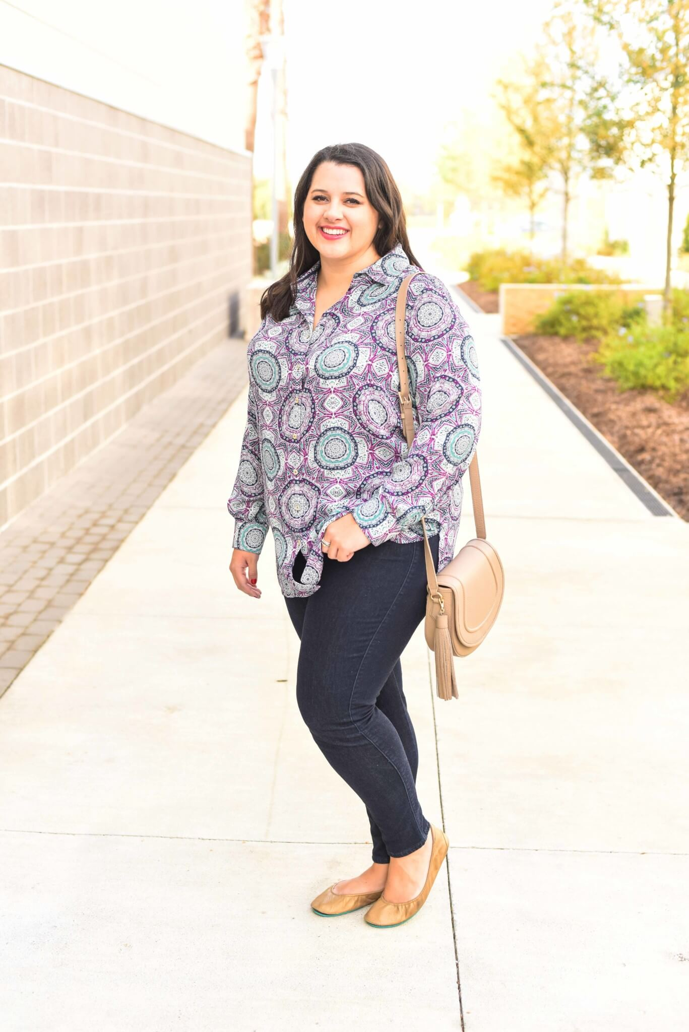 How to style a colorful top for work and play. This colorful tunic can easily go from work to a weekend full of activities. I paired this top with a pair of jeans which can be worn for a casual day at work.