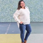 http://curvycontemporary.com/fringe-sleeve-sweater-with-hi-low-hem-in-ivory/