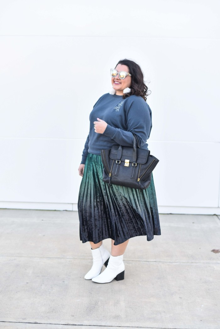 Plus size embroidered sweatshirt plus a velvet skirt, white booties and dazzling sunglasses is totally extra and not expected. #plussizestyle