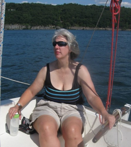 woman at sailboat tiller