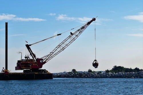 Crane building a new jetty near the Savannah River.
